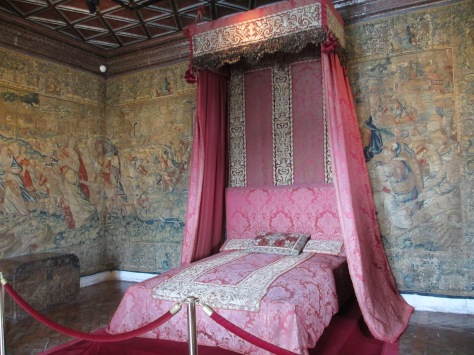 Catherine de Medici either really loved pink or must have really hated the person who picked out the furniture.