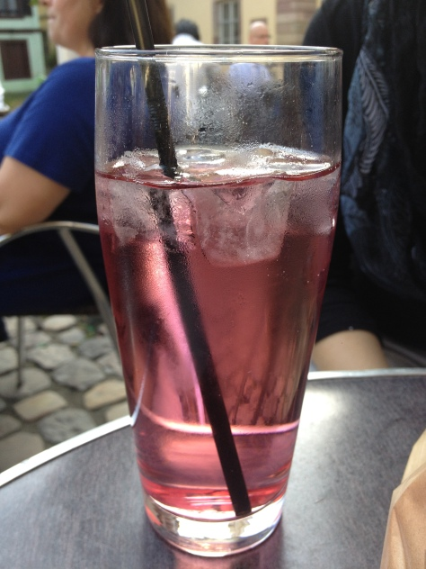Basically Italian soda with flat water, but it tastes so much better than that description.