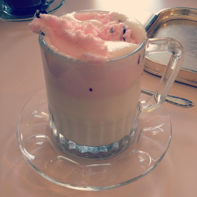 This is white hot chocolate with cardamom topped with handmade rose gelato with dark chocolate pieces. Heaven in a cup.